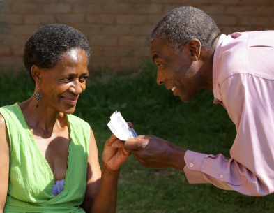 man giving to a elderly woman